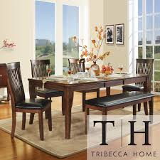 Bring a stylish new look to your dining room with this six-piece cherry  dining