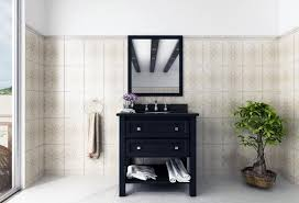 space saving ideas for small bathrooms. lovely cream and white bathroom with black vanity, bonsai tree, beautiful mirror. space saving ideas for small bathrooms