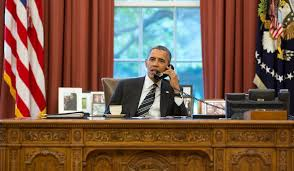 obama oval office. President Barack Obama Talks On The Phone In Oval Office, Sept. 27, Office U