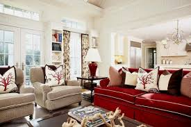scarlet sofa and fabric armchairs with small pillows in a classic living room decorated by lovely