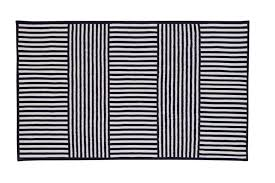 designed in collaboration with noted la based retailer fred segal this striped indoor outdoor rug by cb2 packs a bold graphic punch for your modern