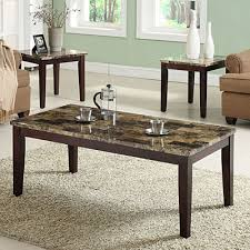 Includes coffee table and two end tables Deep espresso finish Easy-care  faux marble table tops Constructed of wood and wood veneers Assembly  required Coffee ...