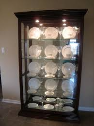 ... things I did was set up our china and crystal in our china cabinet. For  two years, it looked like this, with all the place settings in neat little  rows: