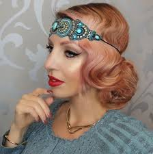 side profile photo of a woman with rose gold pink hair in a 1920s gatsby style