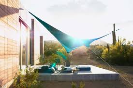 outdoor patio in the desert covered with shade sail made using teal sunbrella contour fabric