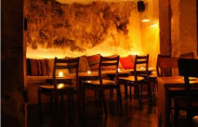 subdued lighting. A Plush Decor And Subdued Lighting In Venues With Boudoir Or Lounge Atmosphere.