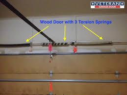 three torsion spring wood door garage door four springs