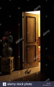 open door with women shoes stock image