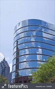 Curved Architecture Office Architecture Curved Blue Glass Building In Trees Stock