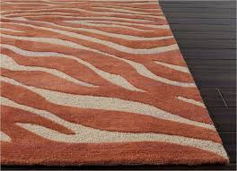 jaipur brio animal magnetism hand tufted animal print pattern polyester orange ivory area rug