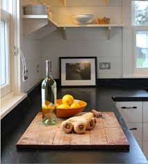 above my kitchen counters over the years have included granite stainless wood and soapstone a favorite for its color feel heat resistance