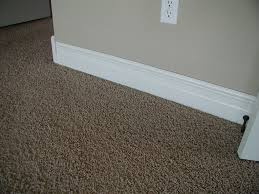 brown carpet floor. Cozy Custom Baseboard Installation With Brown Carpet And Molding For Living Room Designs Floor