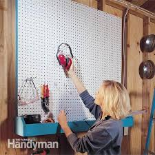 Pegboard storage bins Triton Products In Just Two Hours You Can Install Pegboard On Garage Or Workshop Wall To Create Versatile Upandoutoftheway Storage Add Bin Underneath And Youll Hardis Garage Storage Projects Diy Pegboard Storage Family Handyman