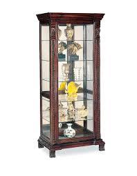 antique living room with dark brown wooden curio cabinet glass shelf and glass doors curio cabinet