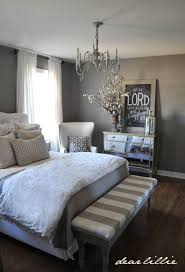 a rustic interplay of sheer white delicate grey and weathered wood bedroom
