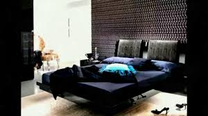 floating bed with dark blue bedding color of cozy bedroom design ideas
