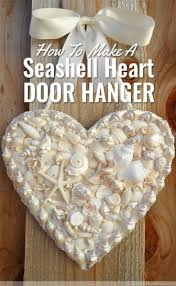 Make a DIY heart-shaped door hanger with seashells, pearls, and rhinestones.