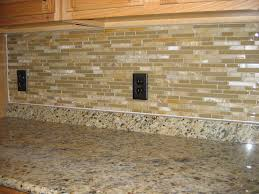 simple kitchen with brown mosaic glass tile backsplash black double electric socket ideas and