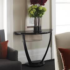 adorable black console table design ideas with black glossy half round table and gray fabric single sofa