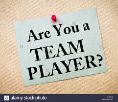 are you a team player message written on recycled paper note are you a team player message written on recycled paper note pinned on cork board motivational concept image