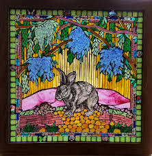 mosaic stained glass window that includes painted and kiln fired pieces