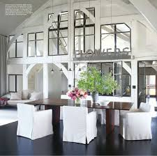 if you do believe in the rug under the table make sure the chairs are on the rug not half on half off happily rug free chez meg ryan in elle decor