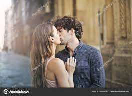 cute couple kissing downtown road stock image