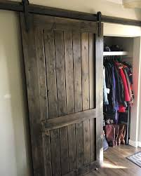his her home sliding barn door over front entrance closet barndoor slidingbarndoor frontentrance closetdoor