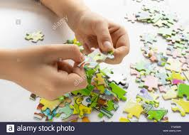Educational Play Light Table Close Up Of Childs Hands Playing With Colorful Puzzles On