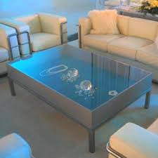 Coffee Tables Resembling Glass Display Cases Contained Outsized Faux  Diamonds And Other Precious Stones.