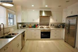 white kitchen pale floors stainless steel in Craftsman - Hooked on Houses