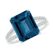 g set at the center of the rous 14k white gold split shank is an emerald cut london blue topaz that is hard to miss sparkling diamonds adorned on