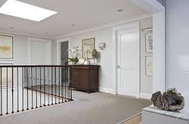 custom l shape gray sisal area rug in hallway of home