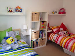 Shared Bedroom For Small Rooms Amazing Boy And Girl Room Ideas With Dolls On The Twin Bed