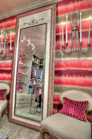 contemporary walk in closet with leaning floor mirror