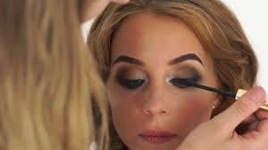 face makeup model while application mascara on eyelashes stylish eyes makeup close up beauty and fashiom industry stock fooe