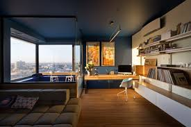 apartment home office. Bright Home Office With Blue Walls, White Shelves And A City View In An Industrial Apartment R