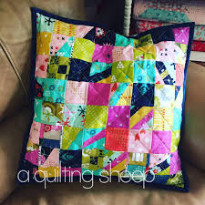 A Quilting Sheep: Quilted Pillow Covers & My couch pillow covers were looking dingy and ugly. It was long overdue  time to get some new ones made. I used this easy pattern. Adamdwight.com