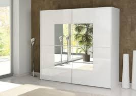 amazing white home depot closet doors with mirrors and standfloor lamp also granite wall background