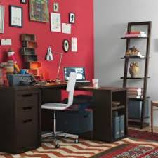 red home office. eclectic home office with colorful layered rugs red k