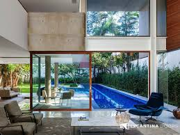 these projects have large pieces of glass floor to ceiling glass and often large sliding or folding doors
