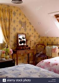 Pink And White Wallpaper For A Bedroom Pink Cottage Bedroom With Floral Wallpaper And Brass Bed Stock