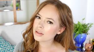 everyday glowy summer makeup tutorial tanya burr emma watson inspired braided low bun hairstyle
