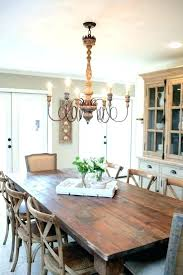 wonderful long dining room sideboard with art hanging chandeliers over dining tables