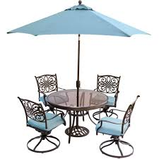 hanover traditions 5 piece outdoor dining set with round glass table swivel chairs