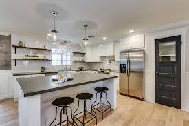 image modern kitchen. modern kitchen with globe pendant clear pietra cardoso limestone countertop industrial swivel barstool image