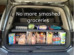 home made pop up shelf car organizer with groceries in back of car