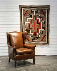 brown vintage navajo rug with red and white design