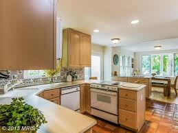 Mexican Tile Kitchen Backsplash Traditional Kitchen With Terracotta Tile Floors Raised Panel In