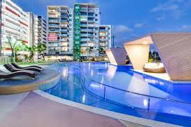 the swimming pool at or close to 2 bed modern inner city apt riverside gardens